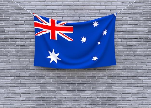 Australien-flagge, die an der backsteinmauer hängt
