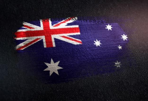 Australien-flagge gemacht von der metallischen bürsten-farbe auf dunkler wand des schmutzes