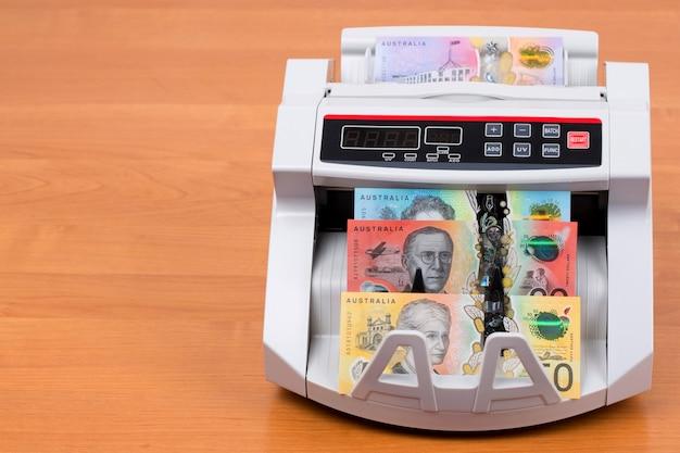 Australisches geld in einer zählmaschine
