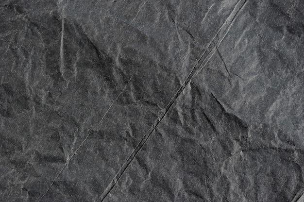 Auszug mit schwarzem geknittertem papier
