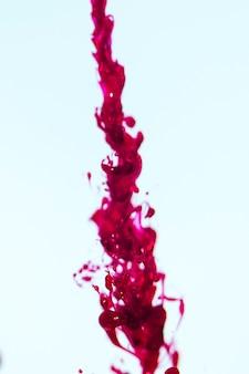 Auszug unscharfes durchgesickertes rotes erröten
