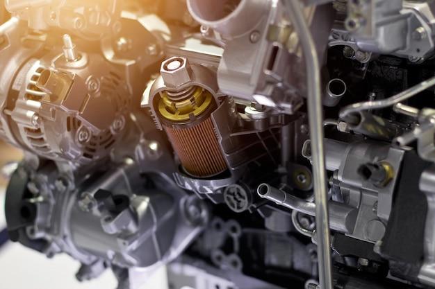 Automotormotorteil, konzept des modernen fahrzeugmotors und geschnittene metallautomotorteildetails