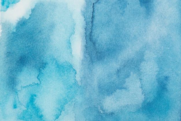 Azurblaue farbmischung auf papier