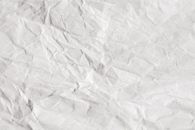 Backgrounf der alten zerknitterten handwerkspaket-packpapierbeschaffenheit