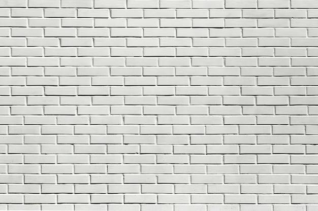 Backstein weißer wandhintergrund. weißes steinmauerwerk. foto in hoher qualität