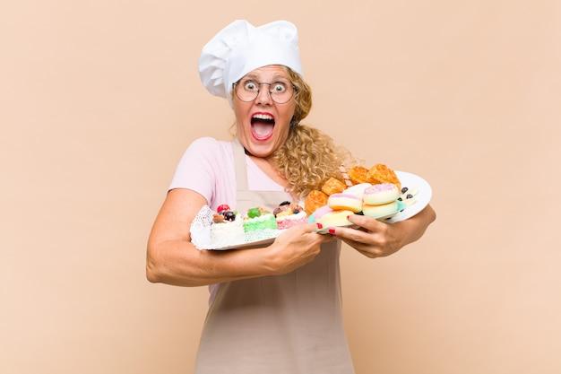 Bäckerin des mittelalters mit kuchen