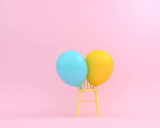 Ballone blauer und gelber pastell mit gelbem stuhl auf rosa hintergrund.