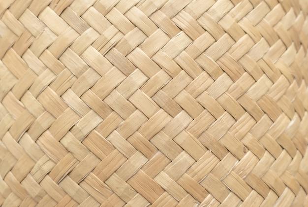 Bambuskorbbeschaffenheit für gebrauch als hintergrund. gesponnenes korbmuster und -beschaffenheit.