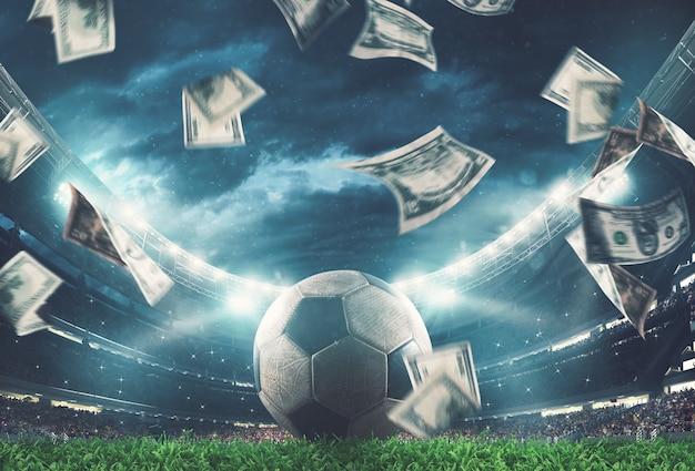 Banknoten regnen auf dem fußballfeld