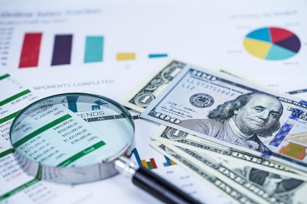 Banknotengeld des us-dollars auf diagramm