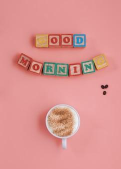 Banner einer tasse kaffee und inschrift guten morgen auf rosa hintergrund