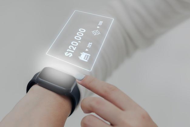 Bargeldloses bezahlen holografische smartwatch-zukunftstechnologie