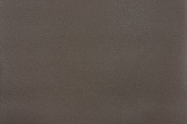 Battleshop grau strukturierter glattlederoberflächenhintergrund, kleine körnung