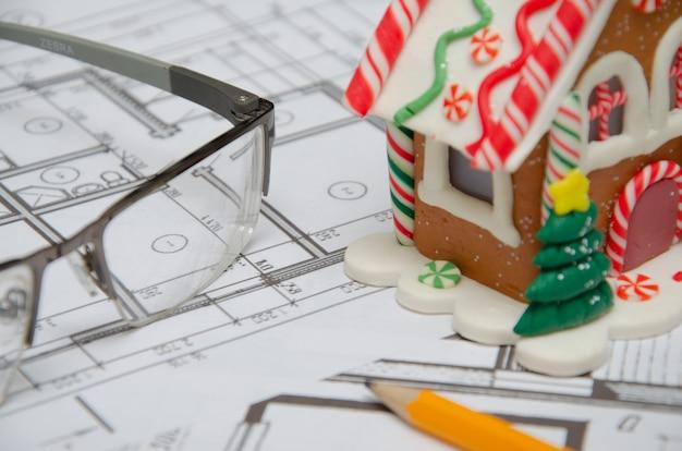 Bau des gebäudegrundrisses, baufinanzierung, dollarpakete, bauzeichnung auf papier, gerollte zeichnungen.