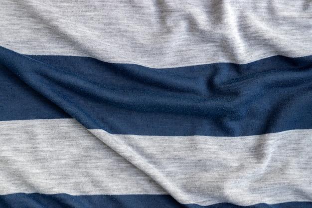 Baumwolljersey gestreifter stoff mit pillenstruktur zerknitterter blauer und grauer textilhintergrund