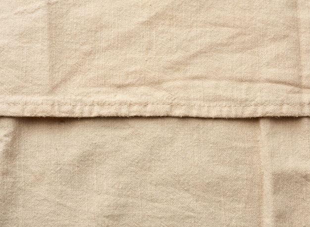 Beige baumwollstoff textur mit nähten, vintage küchenserviette, vollrahmen