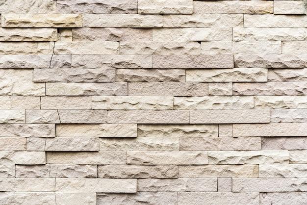 Beige kalkstein gestapelte wandbeschaffenheit. perfekt für den hintergrund.