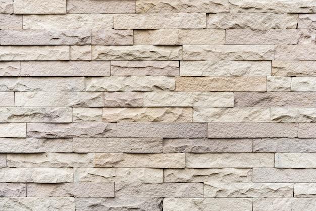 Beige kalkstein gestapelte wandbeschaffenheit.