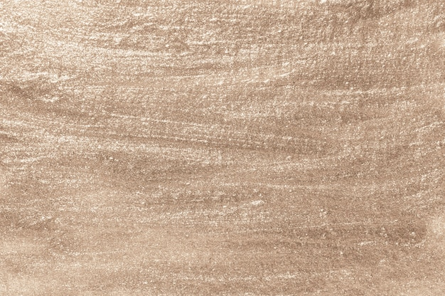 Beige lackierter strukturierter wandhintergrund