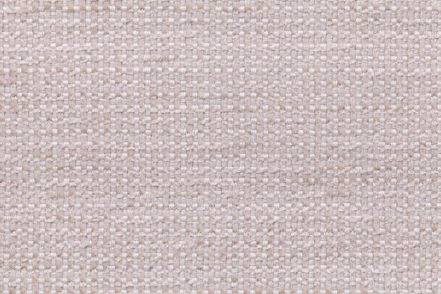 Beige textilhintergrund mit kariertem patterno.