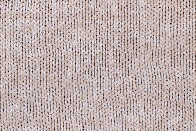 Beige textur aus gestricktem wollpullover. handstricken.
