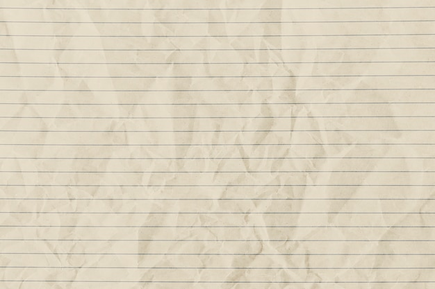 Beige zerknittertes liniertes papierhintergrund