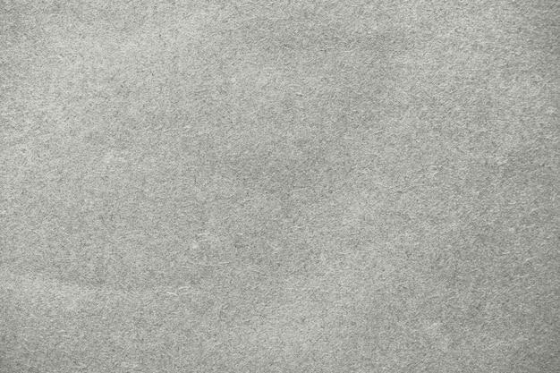 Beigefarbener strukturierter hintergrund aus kraftpapier