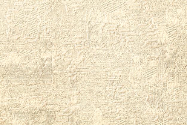 Beiger hintergrund mit relief und gewellter textur.