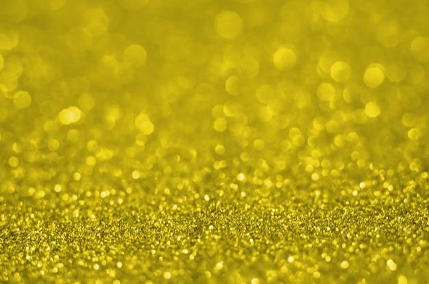 Beleuchtende pantone-farbe des jahres 2021. abstrakter bokeh-hintergrund