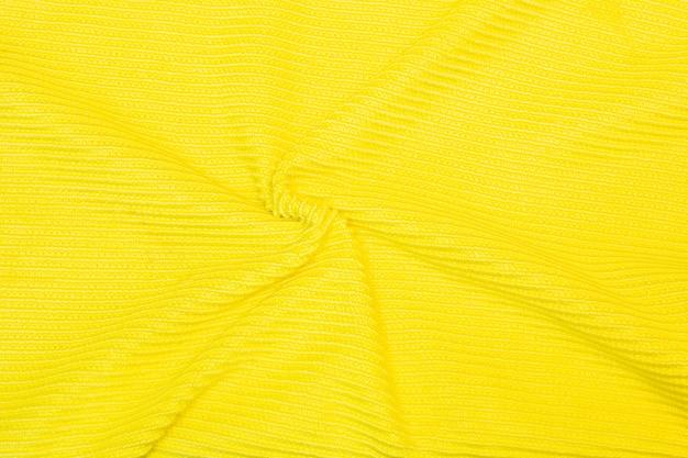 Beliebter bananengelber stoff wellen hintergrundtextur und muster des gelben stoffes