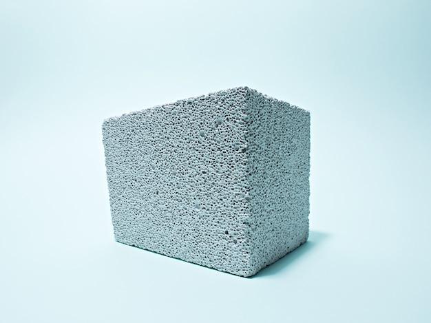 Belüfteter betonblock auf blauem hintergrund
