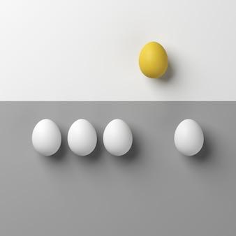 Bemerkenswertes gelbes ei mit weißen eiern auf weißem und grauem hintergrund minimalart