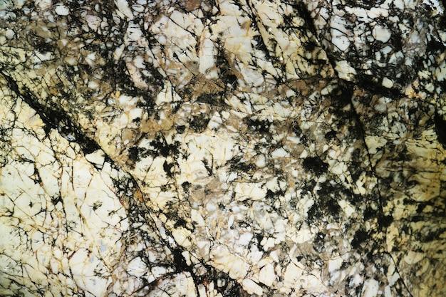 Beschädigen sie die oberfläche der rostkupfergranitfelsen der höhle für die innentapete