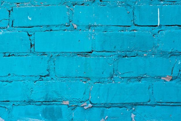 Beschaffenheit der alten blauen backsteinmaueroberfläche mit zementnähten
