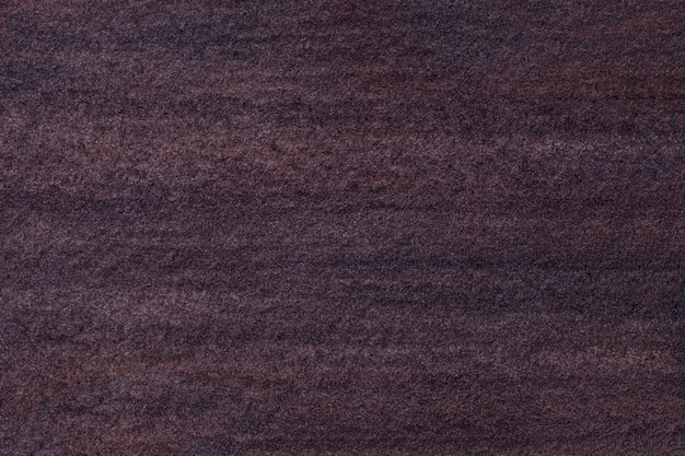 Beschaffenheit der alten dunkelbraunen kunstmalerei mit aquarellpapier, makro.