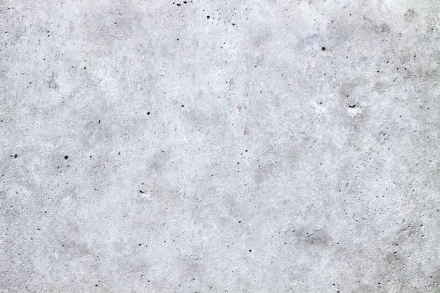Beschaffenheit der alten grauen betonmauer für hintergrund. leerer textfreiraum.