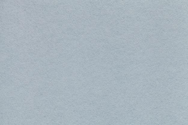 Beschaffenheit der alten hellgrauen papiernahaufnahme. der silberne hintergrund