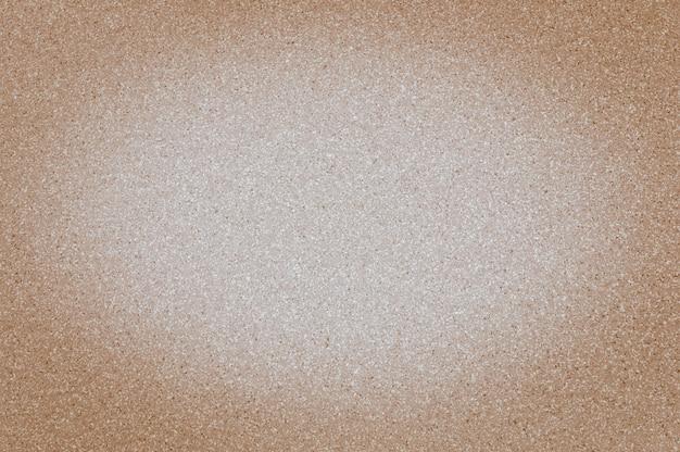 Beschaffenheit der braunen farbe des granits mit kleinen punkten, mit vignettierung, gebrauchshintergrund.