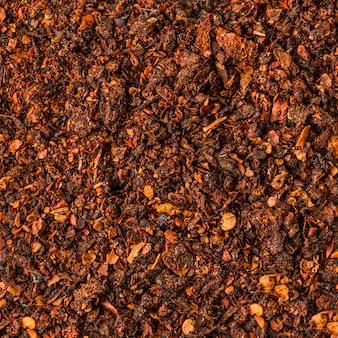 Beschaffenheit der getrockneten tomatenpulver-hintergrundbeschaffenheit