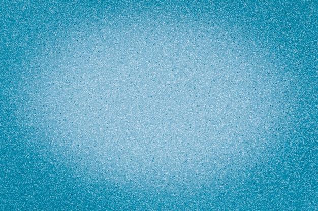 Beschaffenheit der hellblauen farbe des granits mit kleinen punkten, mit vignettierung, gebrauchshintergrund.