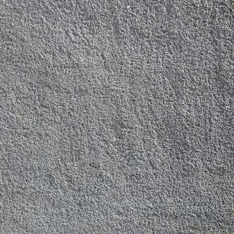 Beschaffenheit der rauen betonmauer mit geprägter beschaffenheit