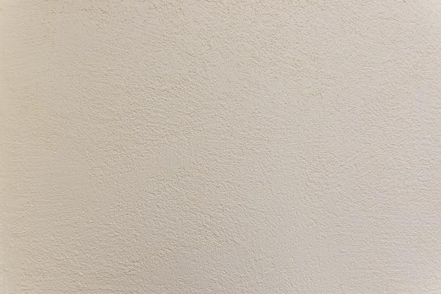 Beschaffenheit der zementwand, oberfläche prägen scharfes und raues muster des konkreten tapetenhintergrundes beige geprägter hintergrund. betonmauer