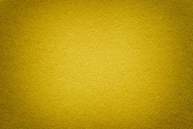 Beschaffenheit des alten goldenen papierhintergrundes, nahaufnahme. struktur aus dichter pappe.