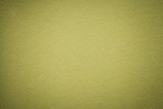 Beschaffenheit des alten olivgrünen papierhintergrundes