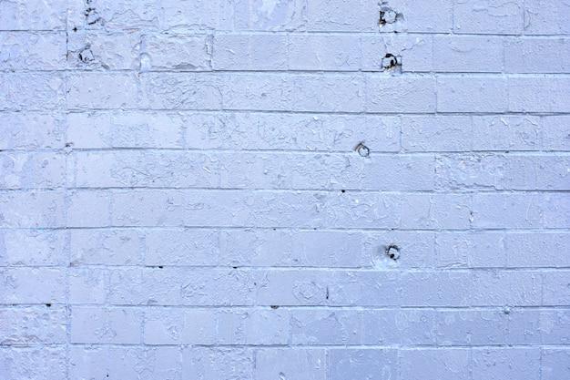 Beschaffenheit des alten weißen und grauen backsteinmaueroberflächenhintergrundes