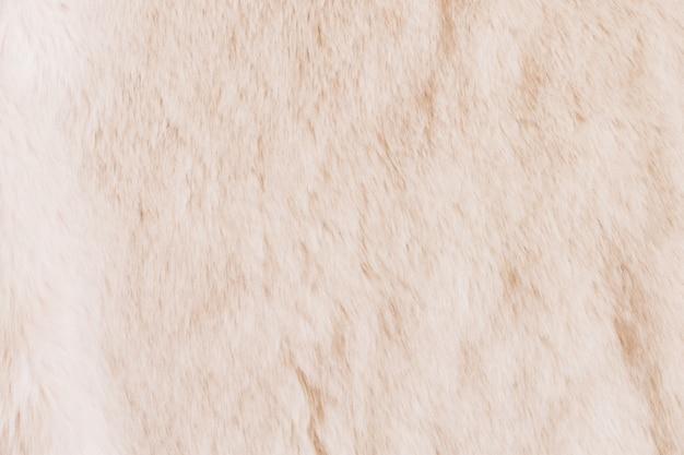 Beschaffenheit des beige shaggy pelzes. tier textur