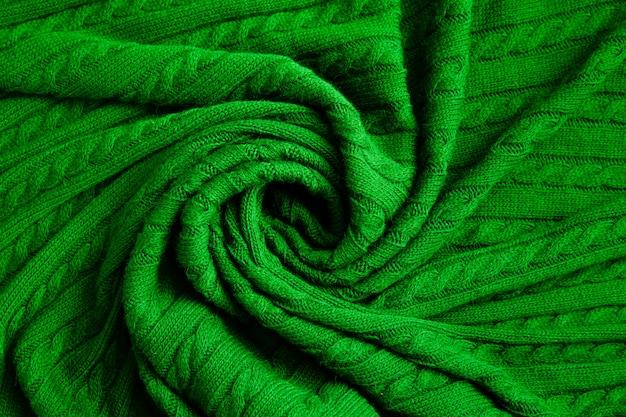 Beschaffenheit des gestrickten grünen gewebes. gehäkelter abstrakter hintergrund.