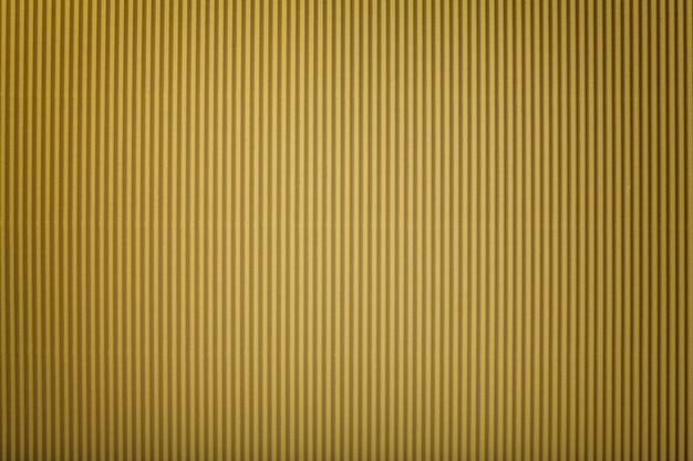 Beschaffenheit des gewölbten goldenen papiers mit vignette, makro.