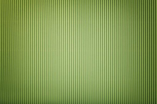 Beschaffenheit des gewölbten hellgrünen papiers mit vignette, makro.