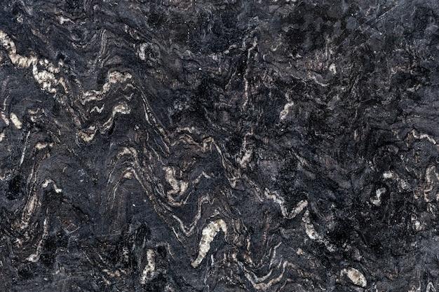 Beschaffenheit des natürlichen polierten dunklen steins. abstrakter hintergrund